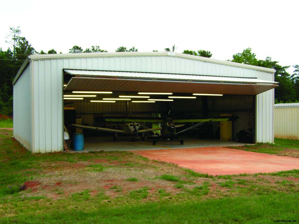 Aircraft Hangar Buildings At Airport Facility Metal Airplane Hangar With  Bifold Door ...
