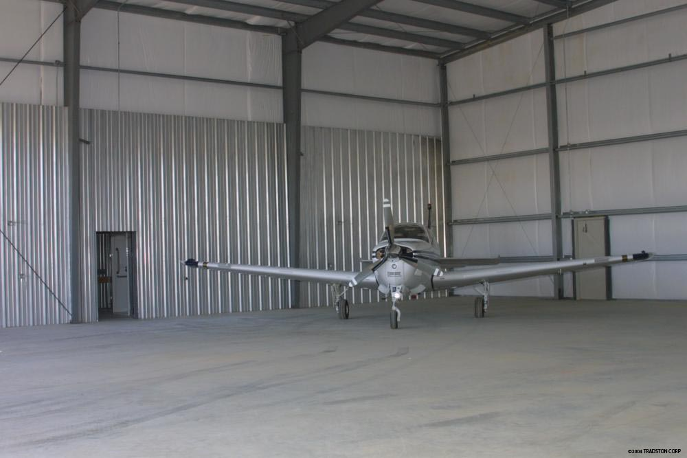 Metal aircraft hangars steel building airplane hangars for Metal building interior ideas