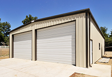residential metal building with two garage doors