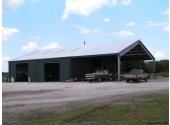 metal farm building with open bay