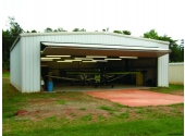 metal airplane hangar with bifold door