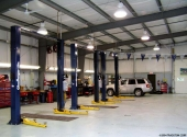 auto repair shop building with car lifts