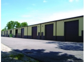 steel office warehouse building with large commercial door