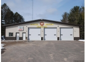 metal fire station building with 4' overhang