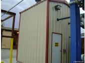 small metal storage shed with walk door