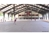 basketball court building with retractable hoops