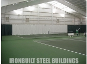 tennis court in prefab metal building with custom flooring and insulation
